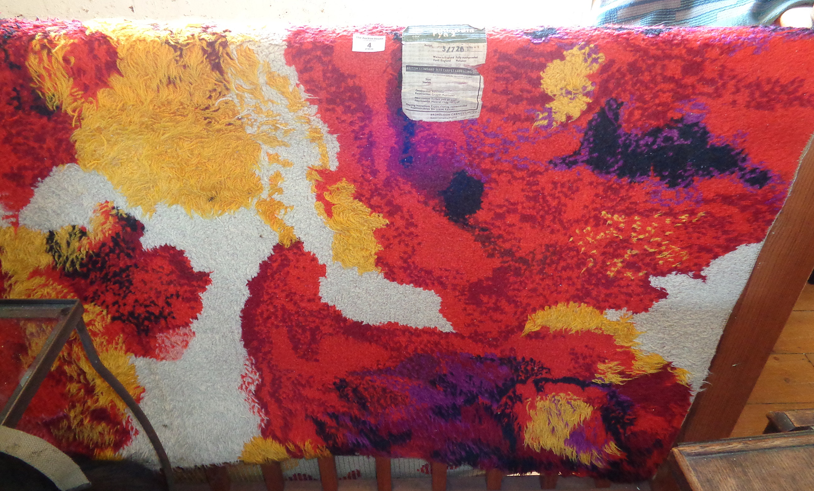 """Lot 4 - A Rya 2 Finlandia rug, mid-century, in bright orange, yellow and red abstract pattern, 54"""" wide x"""