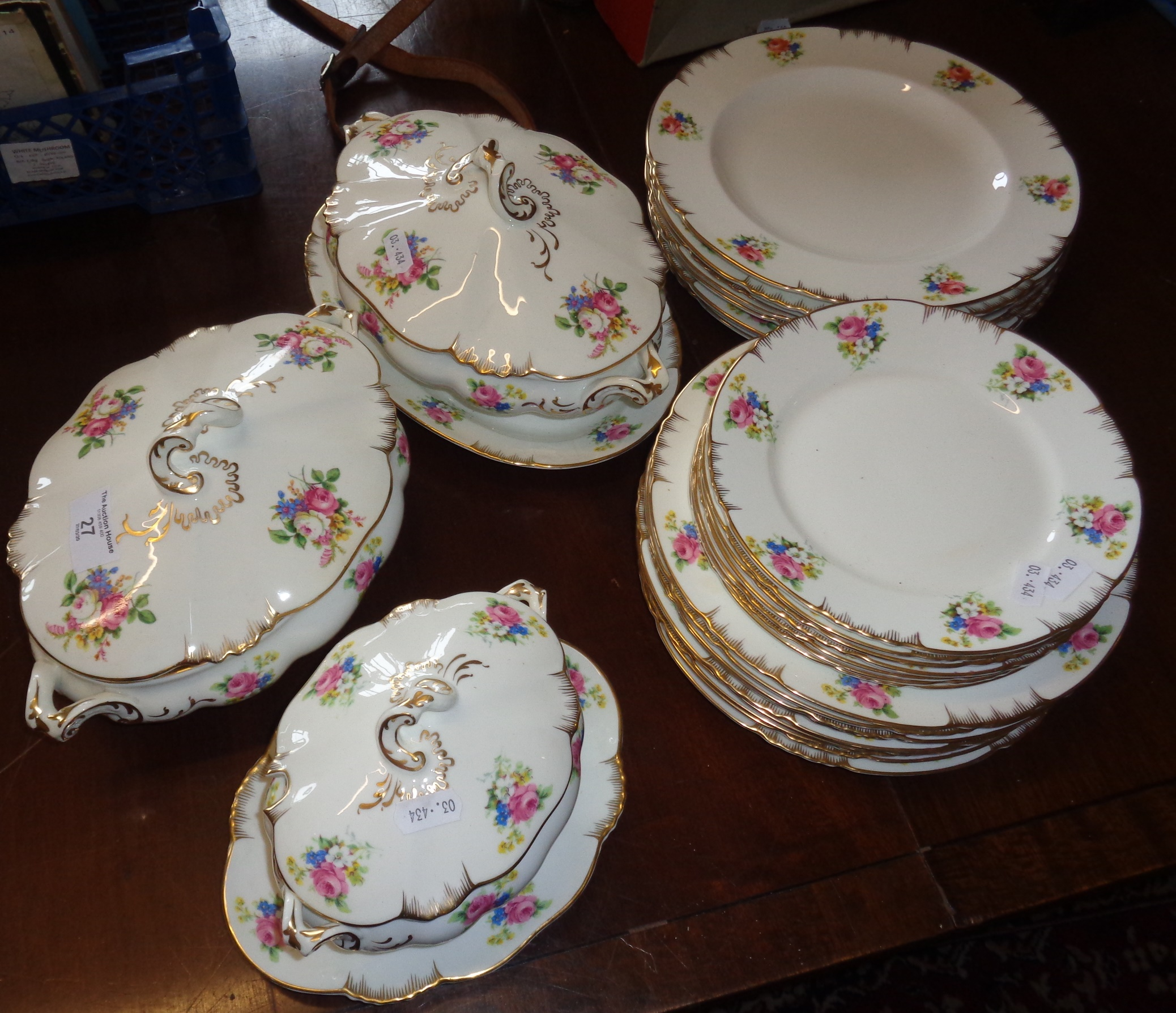 Lot 27 - Crescent china dinner service with floral pattern