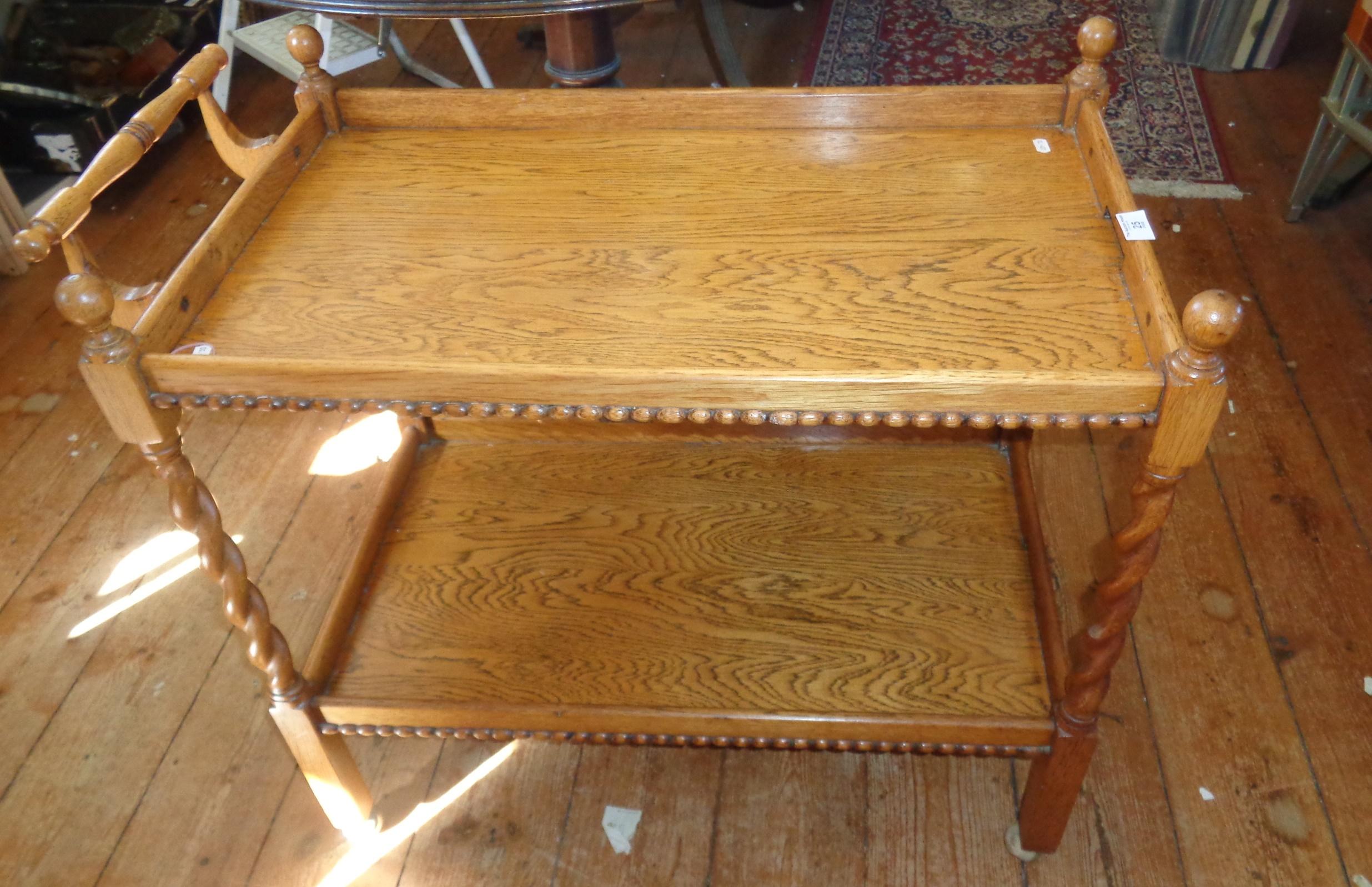 Lot 25 - Light oak two tier tea trolley