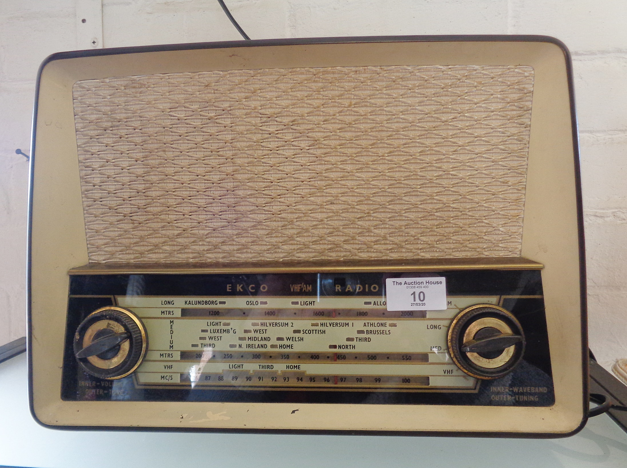 Lot 10 - An Ekco U319 5 valve table radio, c. 1957, in brown bakelite case with brass trim, fully restored