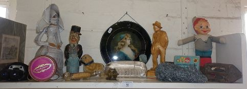 Shelf of assorted items including humorous painted carved figure etc