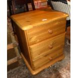 Modern pine bedside chest of three drawers