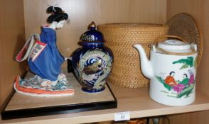 Glass cased Geisha tea girl doll, a vase and a Chinese teapot in basket