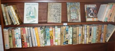 Shelf of children's novels, all with dust wrappers, some First Editions