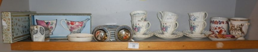 Set of six Royal Doulton 'The Chelsea Rose' pattern coffee cups and saucers, two cabinet cups and