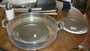 Two 18th century pewter plates, a round galleried silver plated tray and a sugar sifter