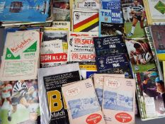 Rugby League - approximately 100 match programmes comprising a varied selection of clubs dating