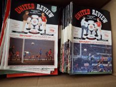 Manchester United - a collection in excess of 180 home match programmes,