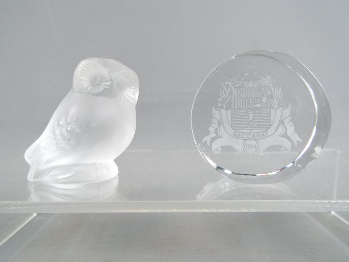 A Lalique frosted glass owl, signed to the base, approximately 5.