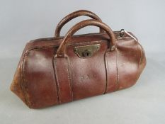 An early 20th century, leather Gladstone bag.