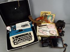 A vintage Imperial 'Safari' portable typewriter in case, cased pair of binoculars, treen,