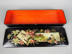 A 19th century black lacquered papier mache glove box with a red painted interior, approx 4.