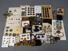 A collection of various buttons, buckles and similar.