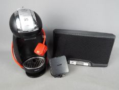 A Bose SoundDock Portable Digital Music System and a Krups Dolce Gusto coffee machine.