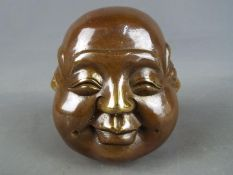 A brass four faced Buddha.
