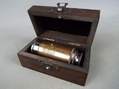 A small brass marine telescope in box.