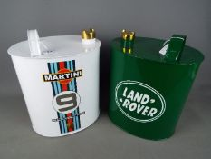 Two reproduction petrol cans, Land Rover and Porsche, approximately 35 cm (h).