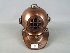 A metal reproduction of a diver's helmet,