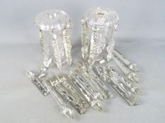 A pair of early 20th century clear glass lustres with a quantity of additional drops.