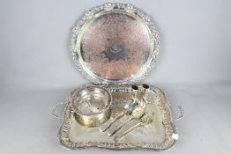 Georgian Silver - two hallmarked silver serving spoons with embossed depictions of fruits to the