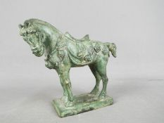 A small bronze horse, approximately 11 cm (h).