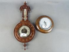 Two wall hanging aneroid barometers [2]