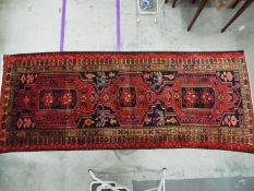A large Persian runner measuring approximately 121 cm x 310 cm