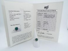 9ct Gold - a 9ct white gold ring set with diamonds and emerald, brilliant shape,size N, weight 0.