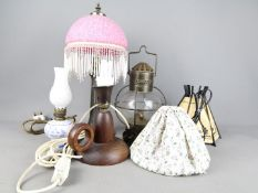 A collection of table lamps, oil lamp, lantern.