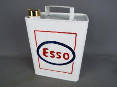 An Esso fuel can, approx 35 cm x 24 cm.