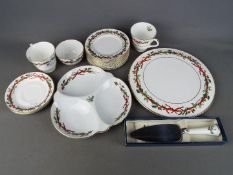 Royal Worcester - A quantity of Royal Worcester ceramics in the Holly Ribbons pattern.