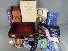 A vintage case containing a quantity of military and Royal related items.
