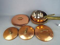 A set of four good quality copper cooking pans.