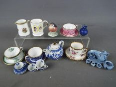 A collection of miniature ceramics to include Spode cups and saucers, Chelson China,