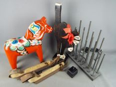 A large wooden painted Dala / Dalecarlian horse, approximately 37 cm (h), electric candle lights,