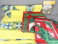 Three American style, patchwork quilts, largest 155 cm x 155 cm and related literature.