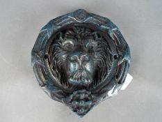 Door Furniture - a large cast door knocker in the form of a lions head