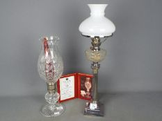 An Elkington Plate oil lamp with glass diffuser,