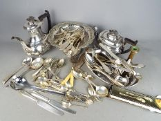 A quantity of plated ware to include tea set, flatware and similar.