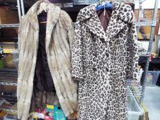 Fashion - a light brown fur three quarter length coat, approx 95 cm length, a dark brown fur coat,