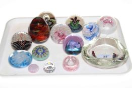Caithness, Mdina and other glass paperweights.