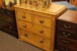 Pine chest of two short above two long drawers.