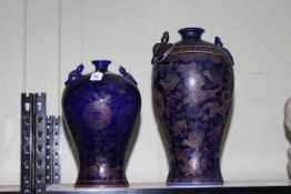 Large and medium powder blue Chinese vases with gilt animal decorations, 37cm and 47cm.
