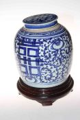 Oriental blue and white ginger jar on wooden stand, 30cm.