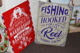Two signs, Fishing and Barber Shop.