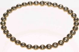 18 carat yellow gold rubover diamond bracelet, approximate diamond content one carat.