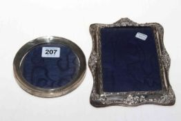 Two silver photograph frames.
