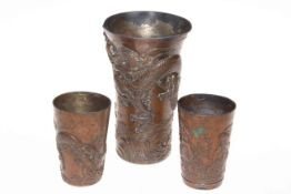 Three Japanese beakers with dragon decoration.