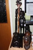 Two tribal masks, two pairs of tribal busts, two figures, stick and shield (9).