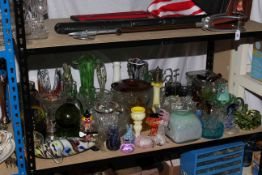 Collection of coloured and clear glassware including two coloured glass fish, clown, paperweights,